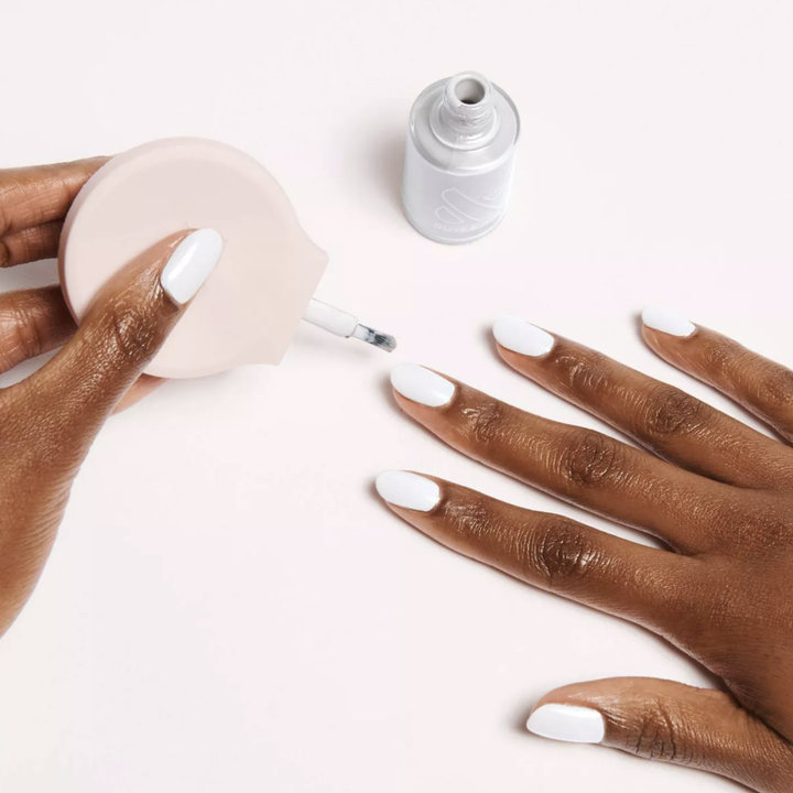 a model painting their nails white