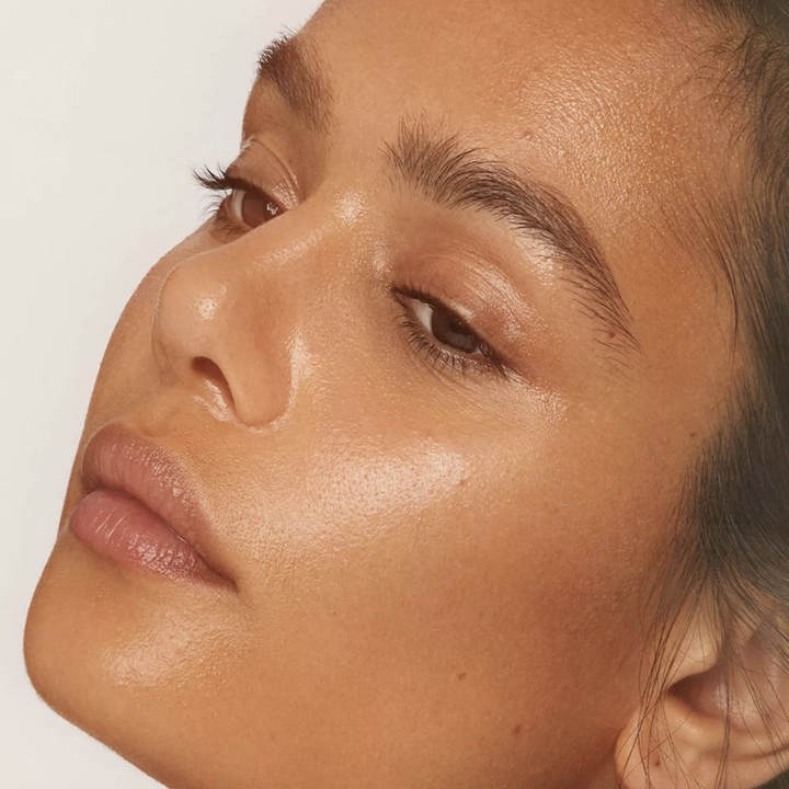 a model with golden glowy skin