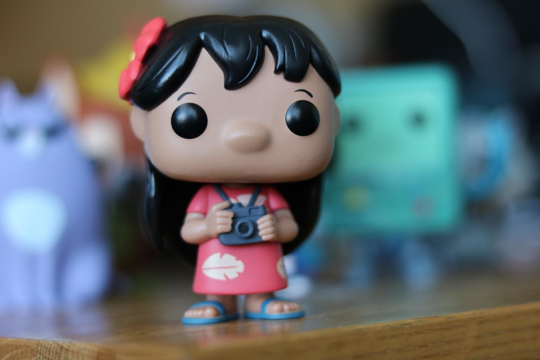 a reviewer's photo of the lilo funko on a shelf