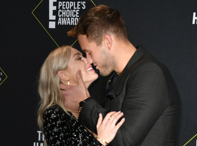 Cassie and Colton smiling, embracing, and pressing their noses together