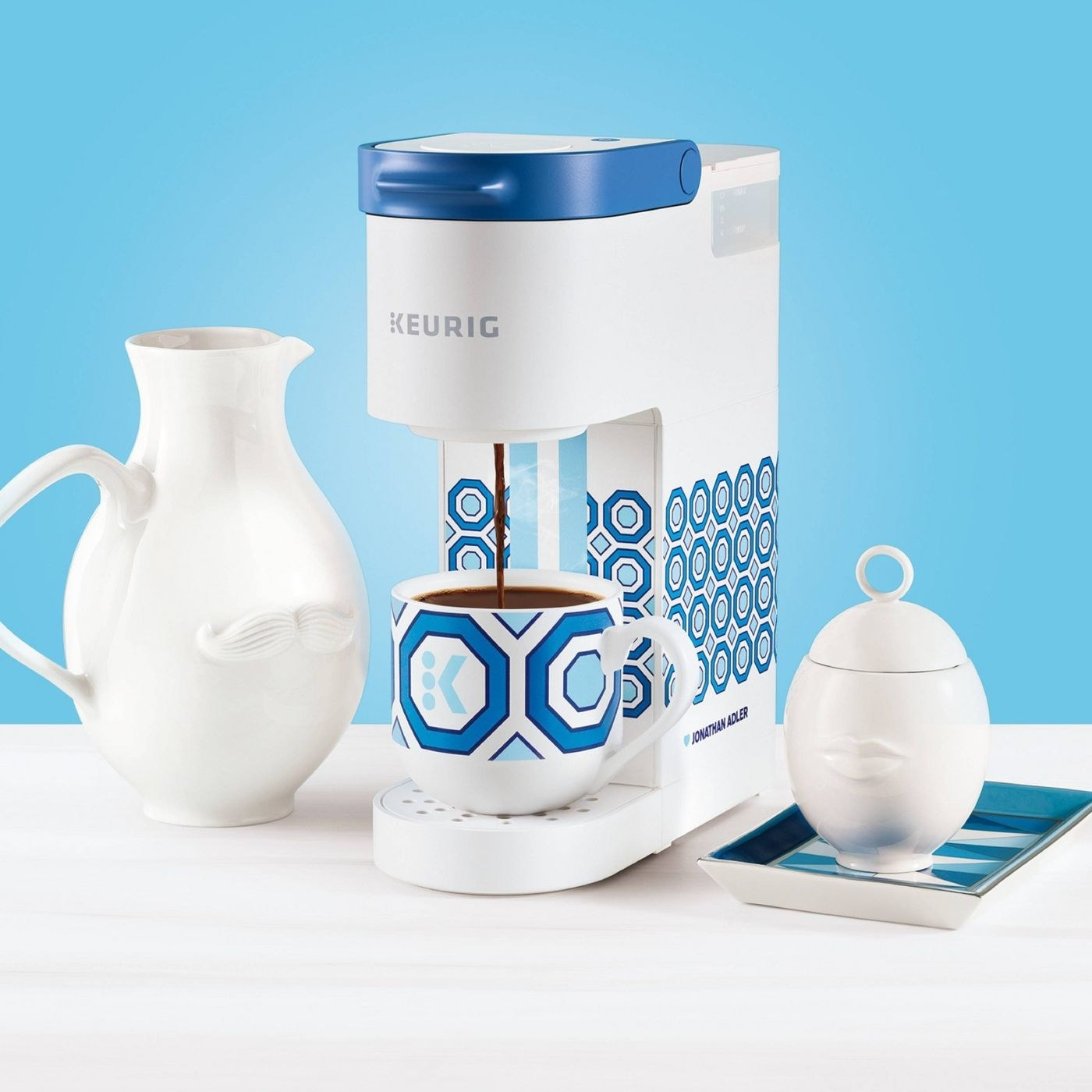 the blue and white tile print coffee maker