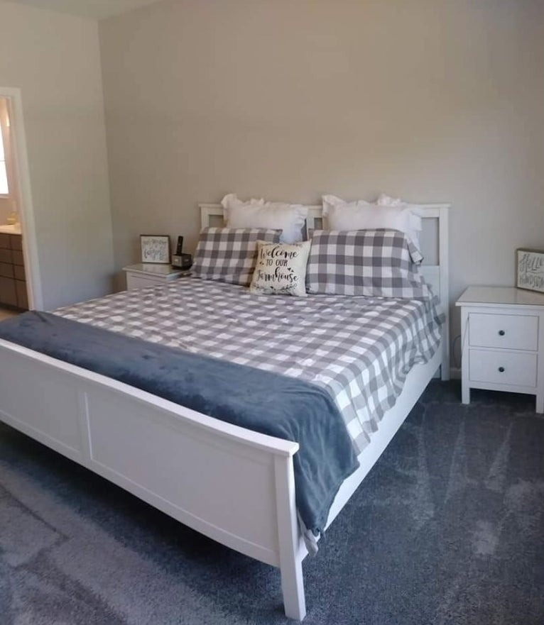A reviewer's home with a plaid duvet cover