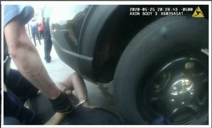 Footage from a police body camera shows Chauvin with his knees on top of Floyd, who is facedown on the ground by a car's tire