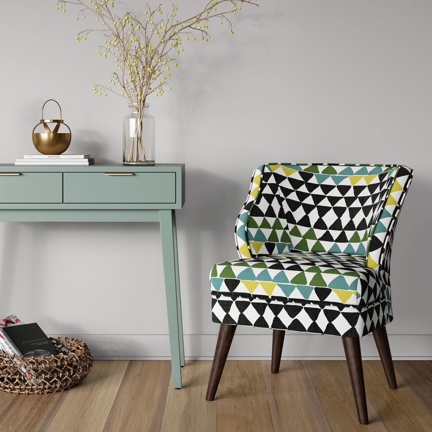 The midcentury armchair in green and blue diamond pattern with brown wood legs