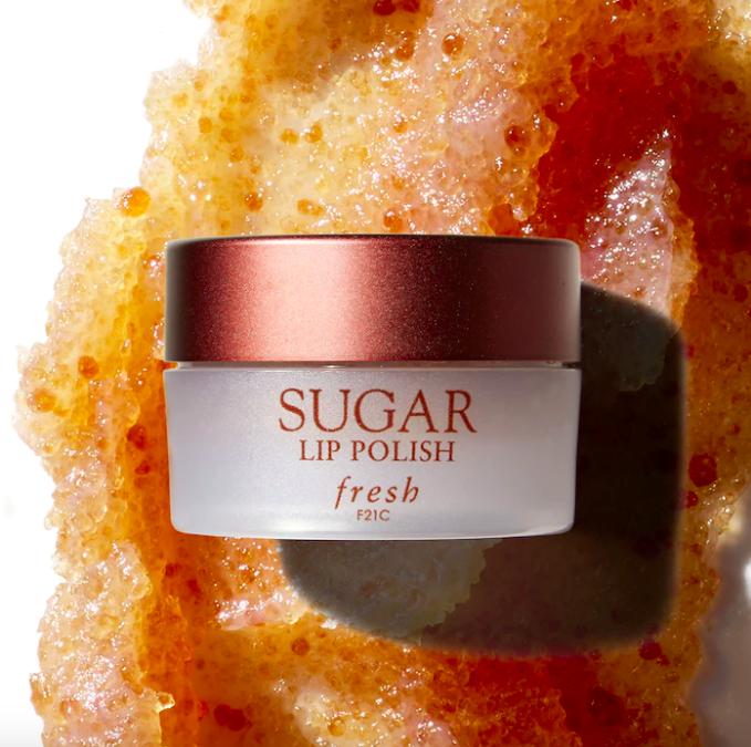 A jar of the lip polish on a smear of the product