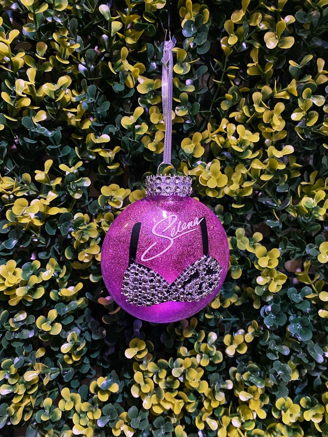 The glittering Selena ornament with the bedazzled bustier