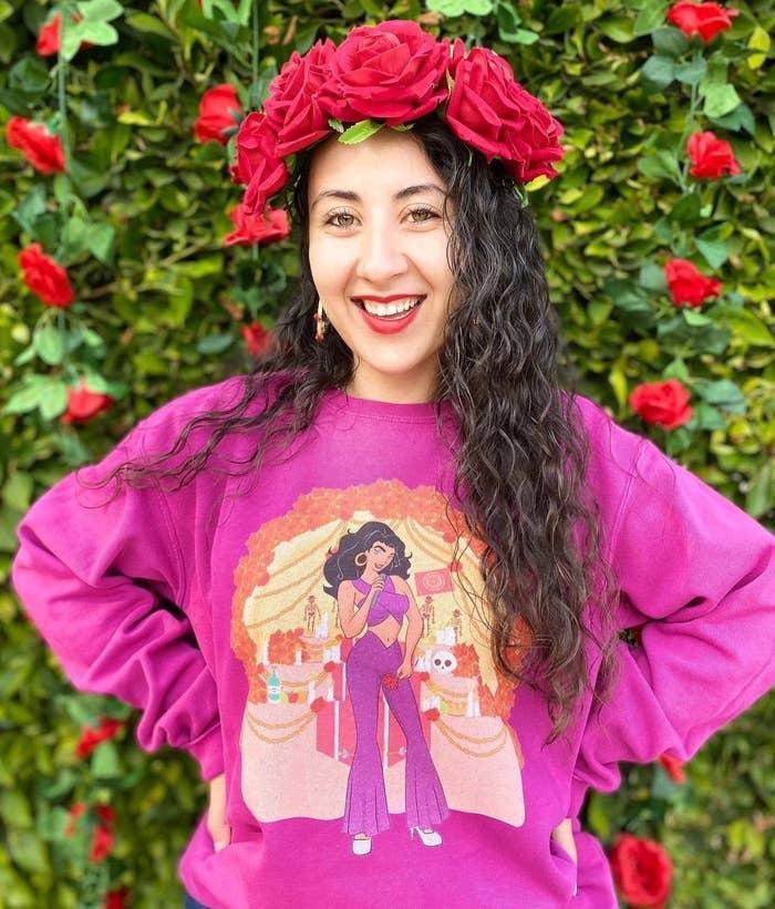 A person wearing the Disney-inspired Selena sweatshirt