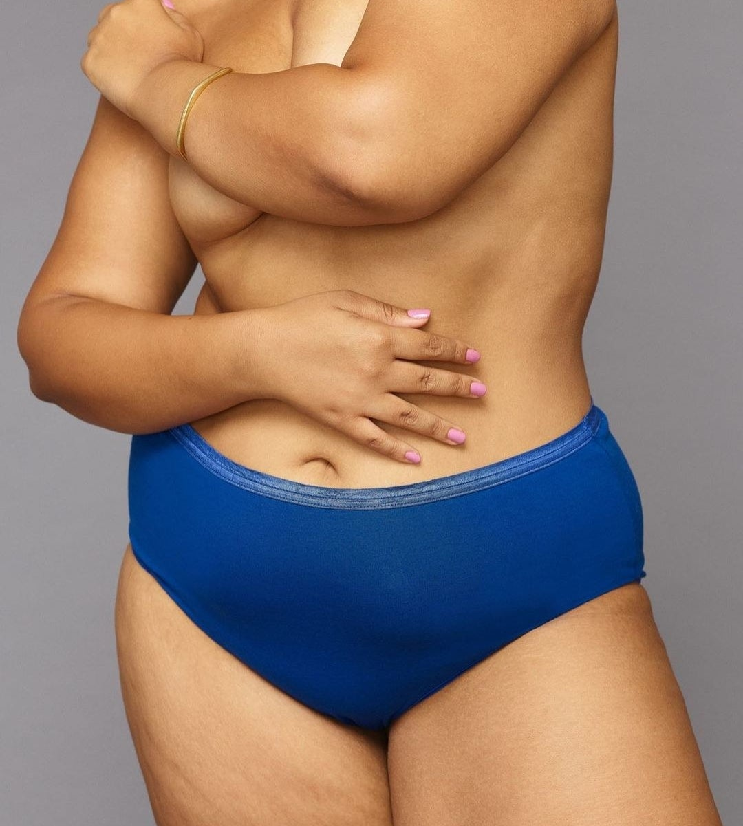 a model wearing a pair of royal blue mid-rise full coverage underwear
