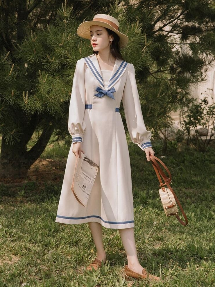 the sailor dress with blue trim