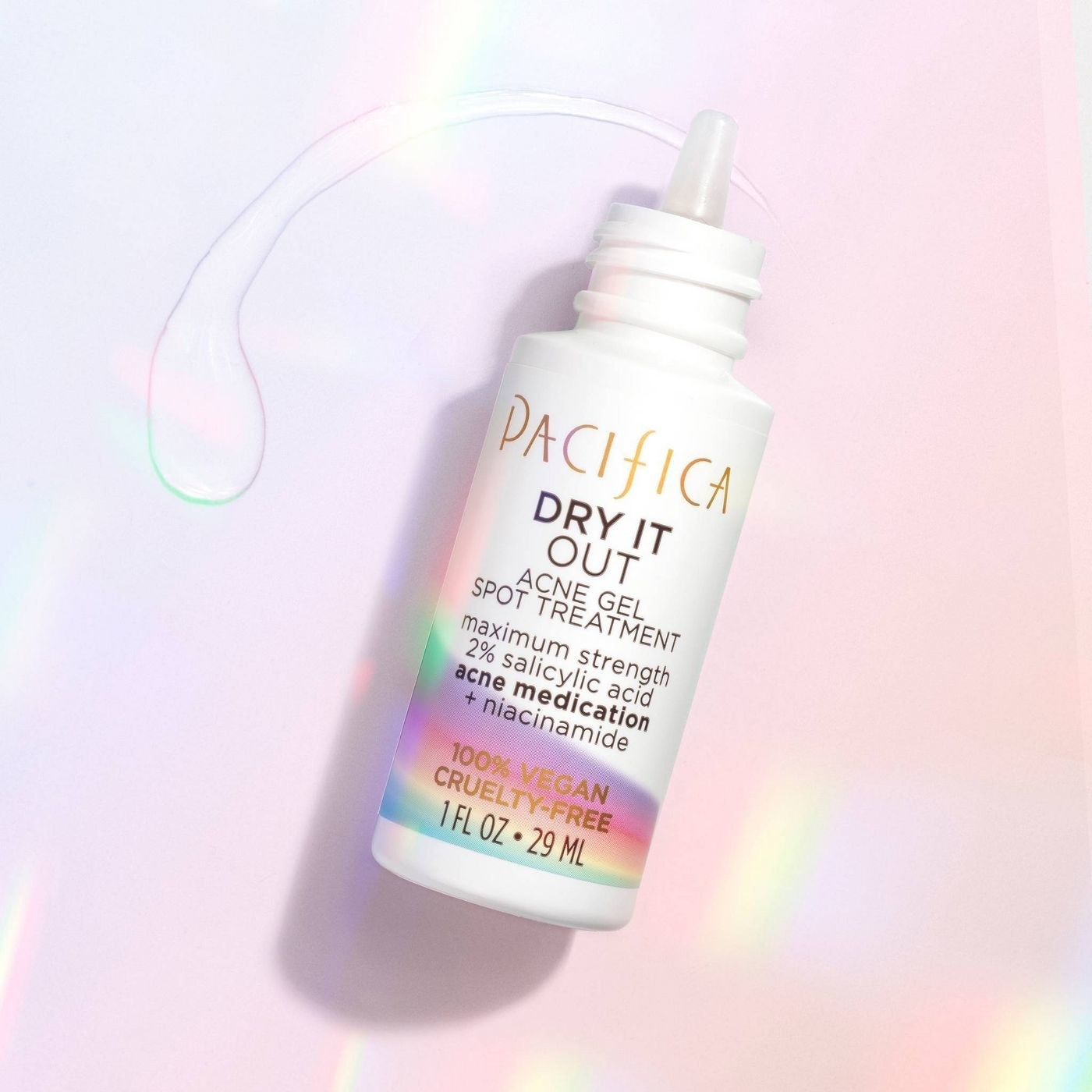 A bottle of acne gel spot treatment on a holographic backdrop