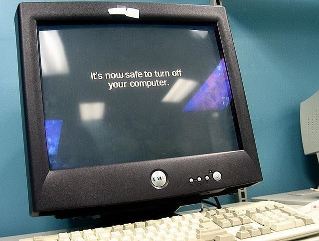 """A Dell computer with """"it's now safe to turn off your computer"""" written on the screen"""
