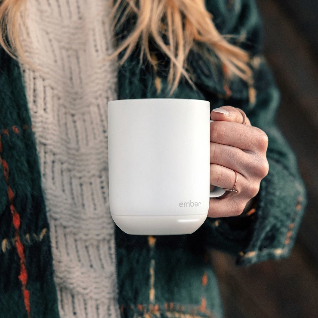 A person holding the ember mug