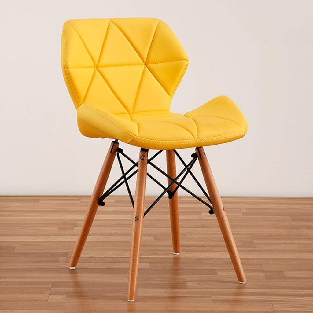 A velour dining chair in yellow