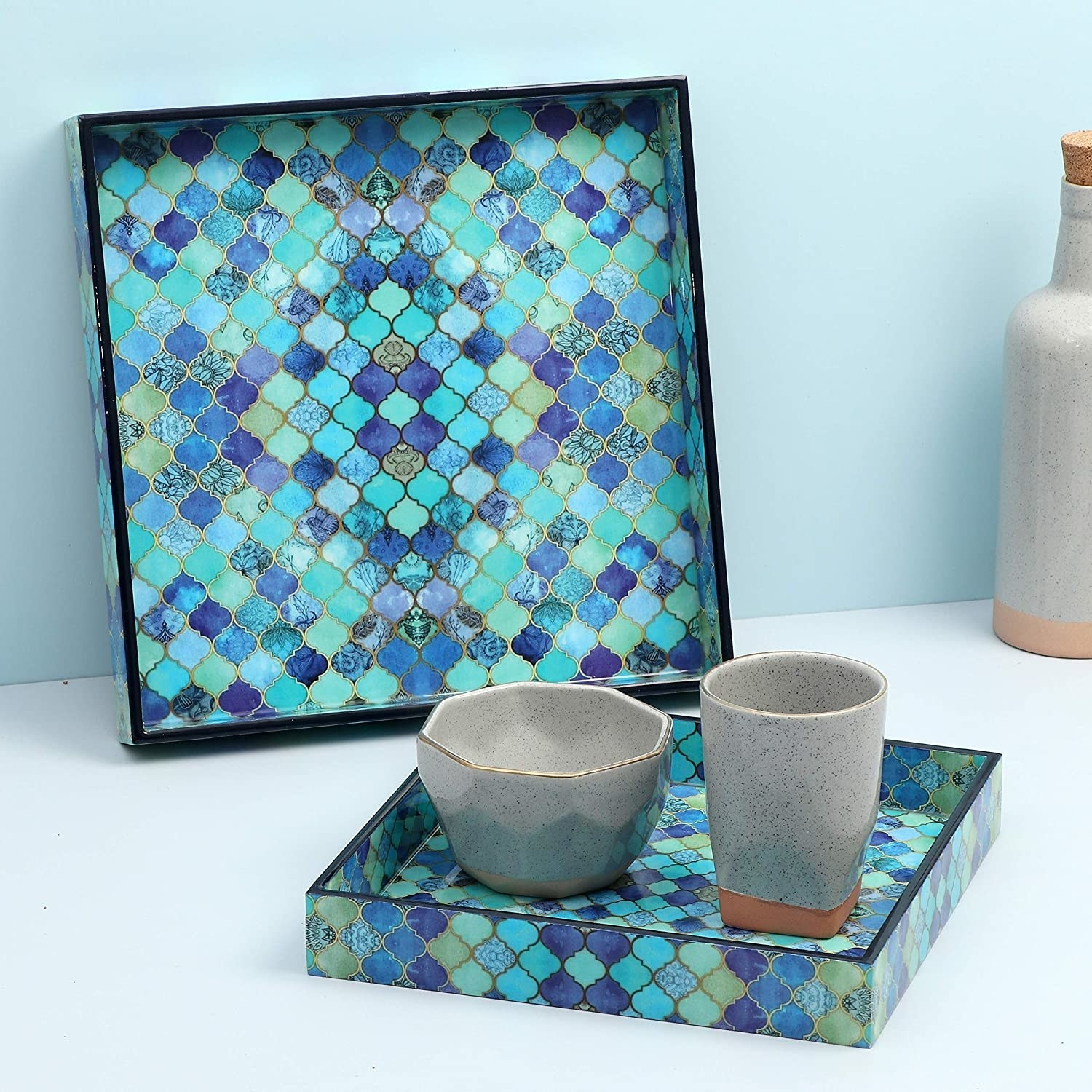 The tray with a bowl and glass on it.