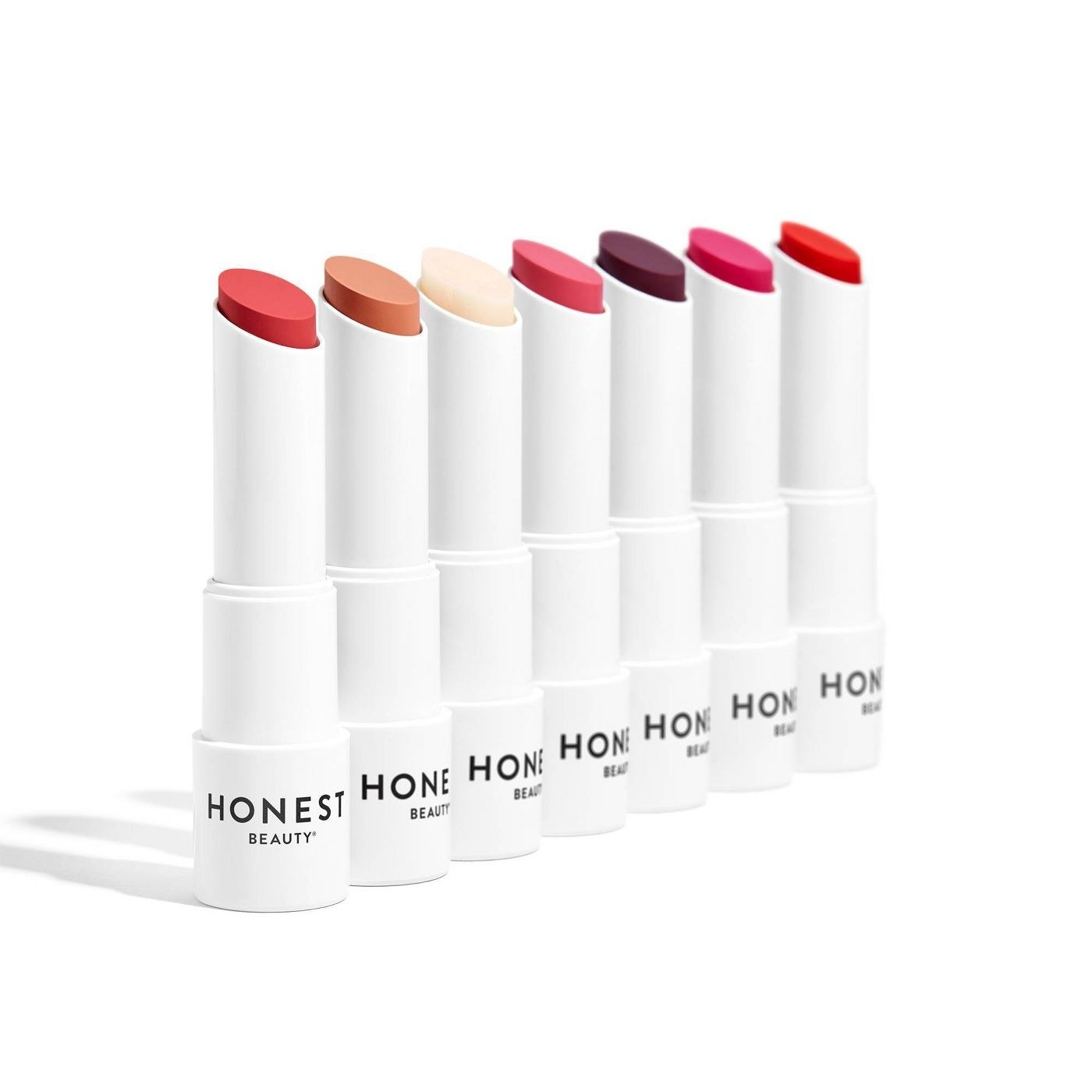 Seven tubes of tinted lip balm lined up