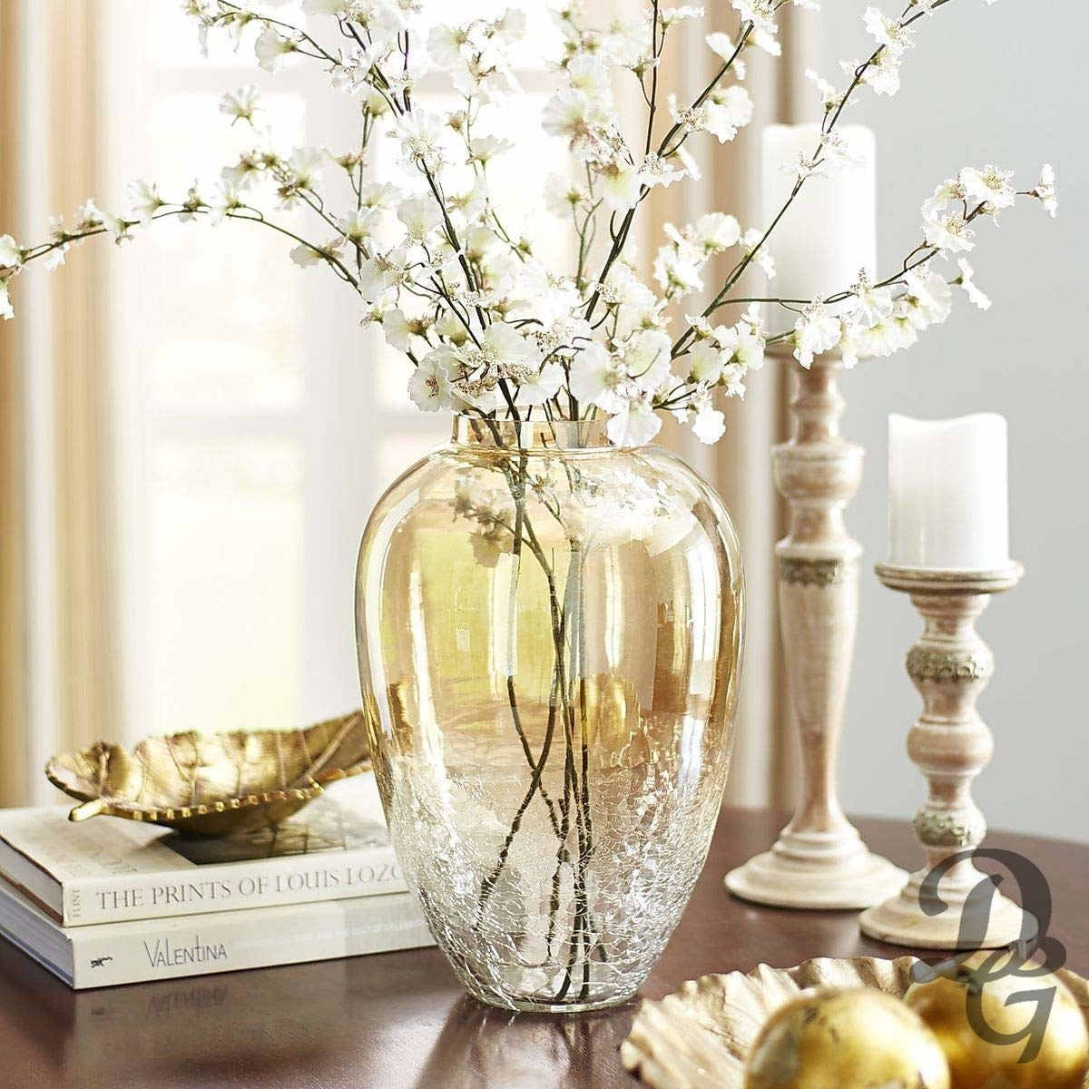 A crackled glass vase with some white flowers kept in it