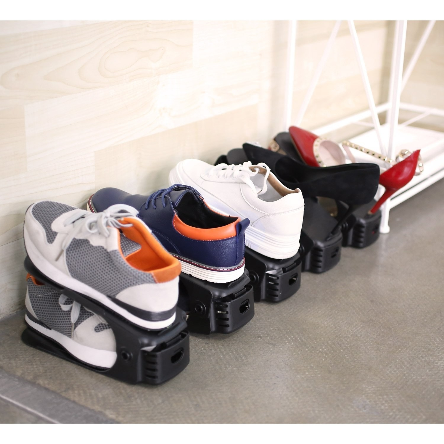 A set of shoe organisers with shoes on them
