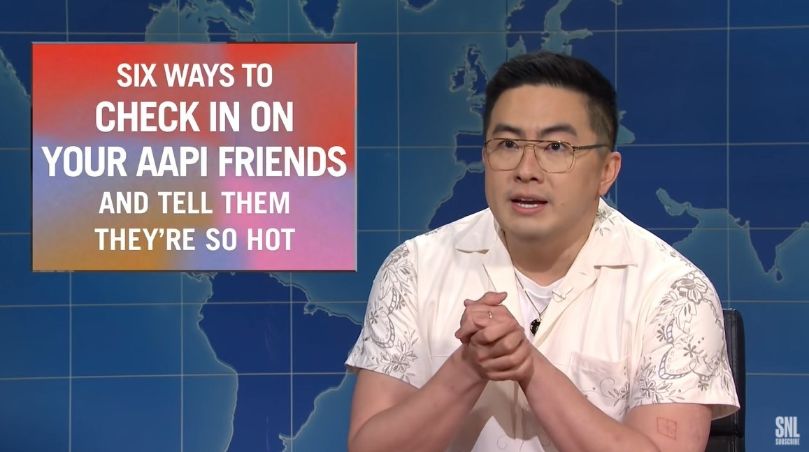 """Bowen Yang on Weekend Update next to """"Six Ways to Check in on Your AAPI Friends and Tell Them They're So Hot"""" infographic"""
