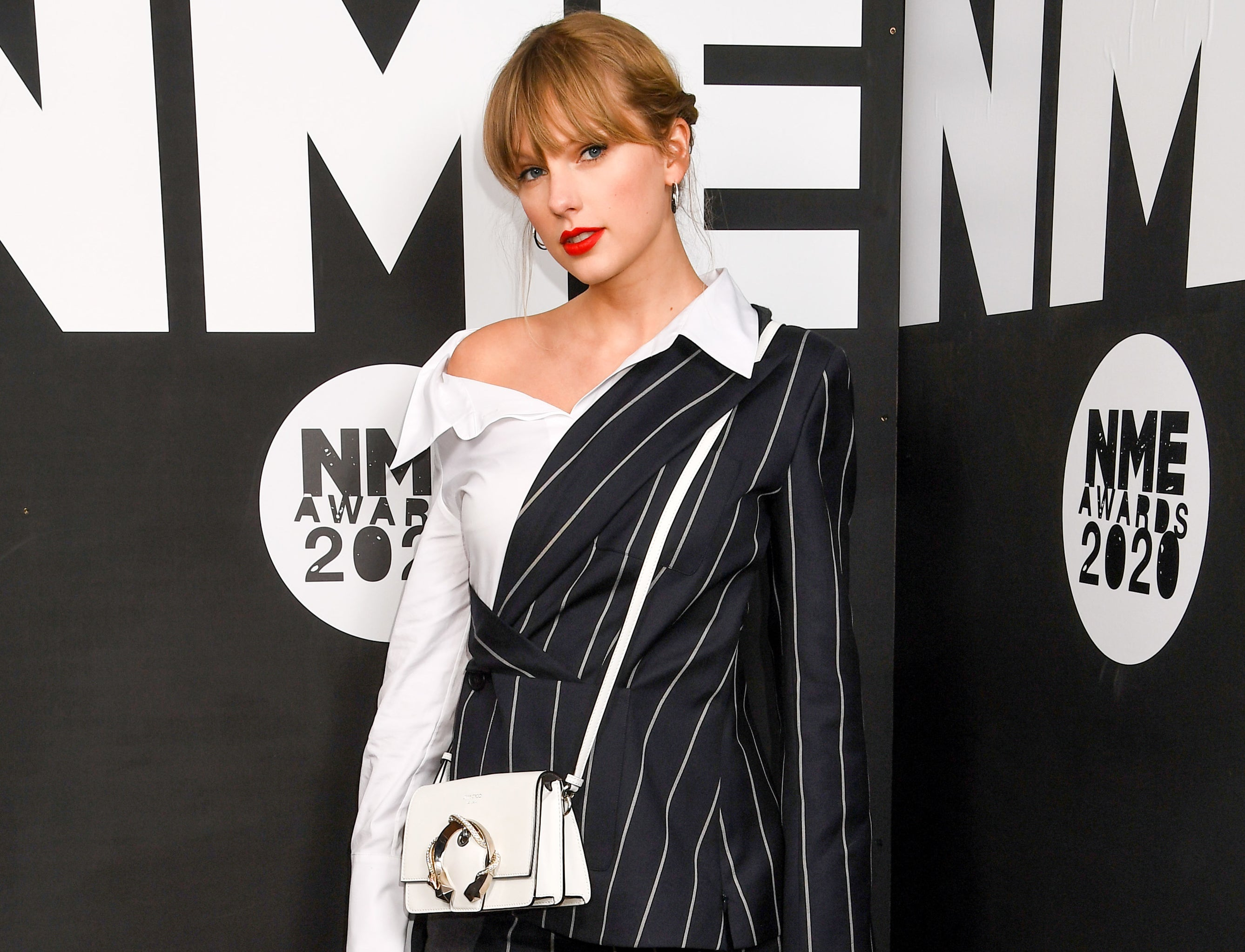 Taylor looks serious at an event