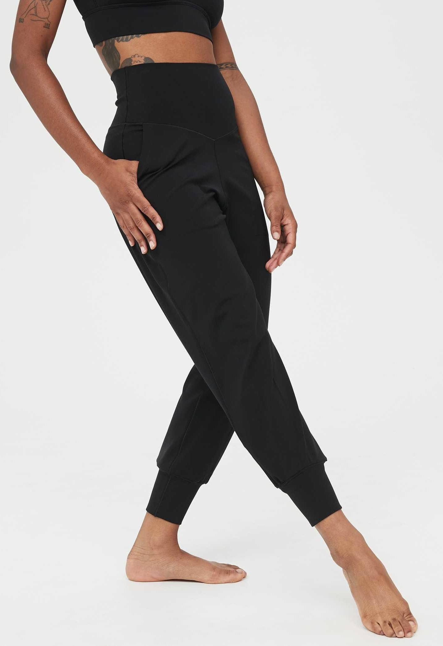 Model wearing the high-waisted joggers in black