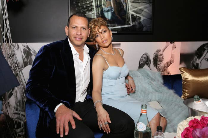 Alex and Jennifer posing for a photo on a couch at an event