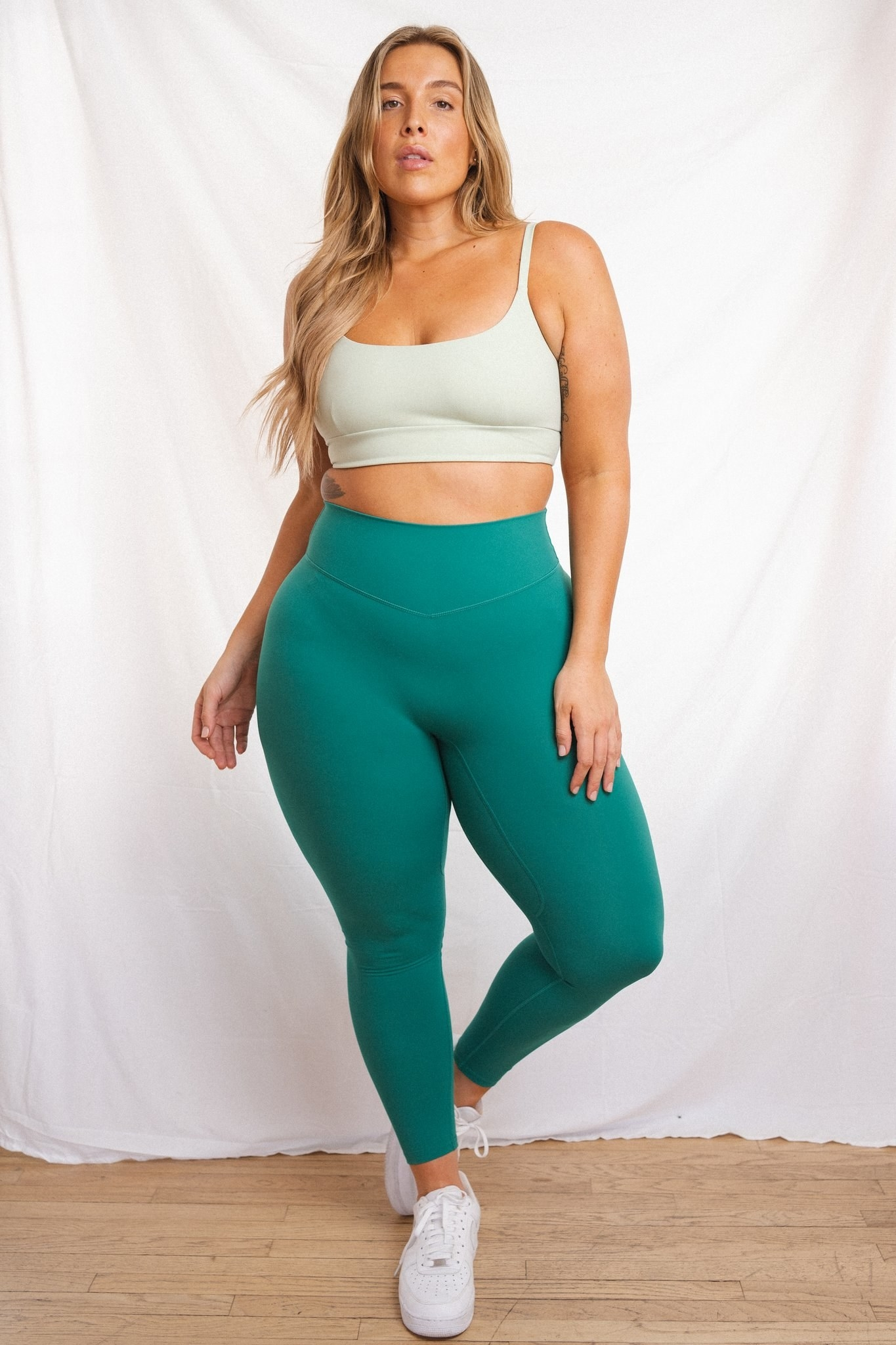 model wearing the green leggings