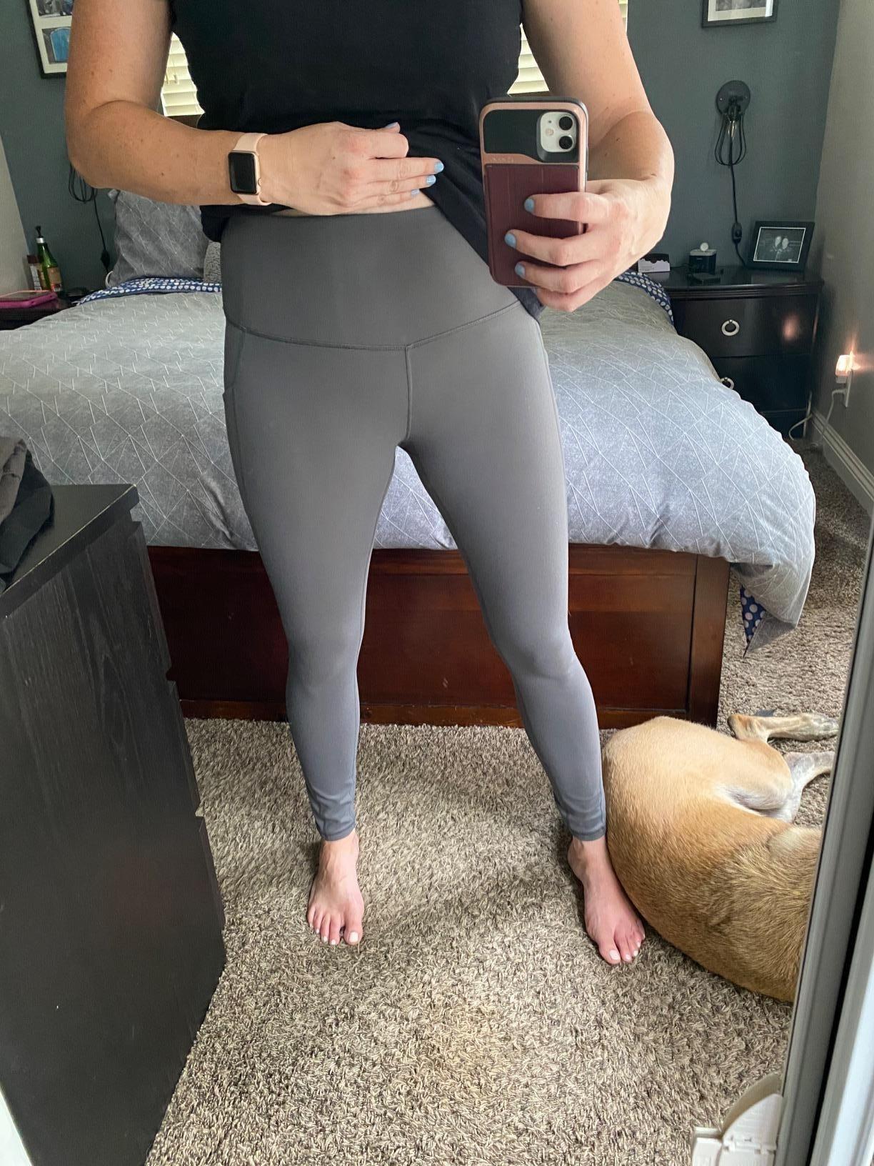 mirror selfie of reviewer wearing the grey iKeep High Waist Yoga Pants