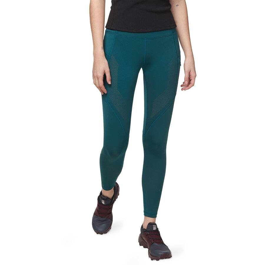 close up of the green backcountry mountain trail leggings on a model