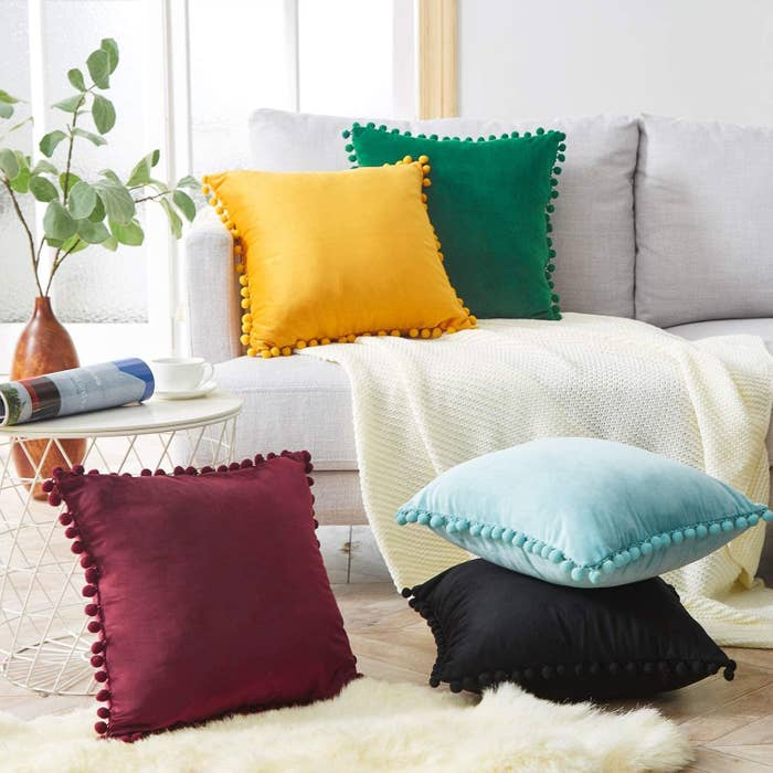 throw pillow with pom pom borders