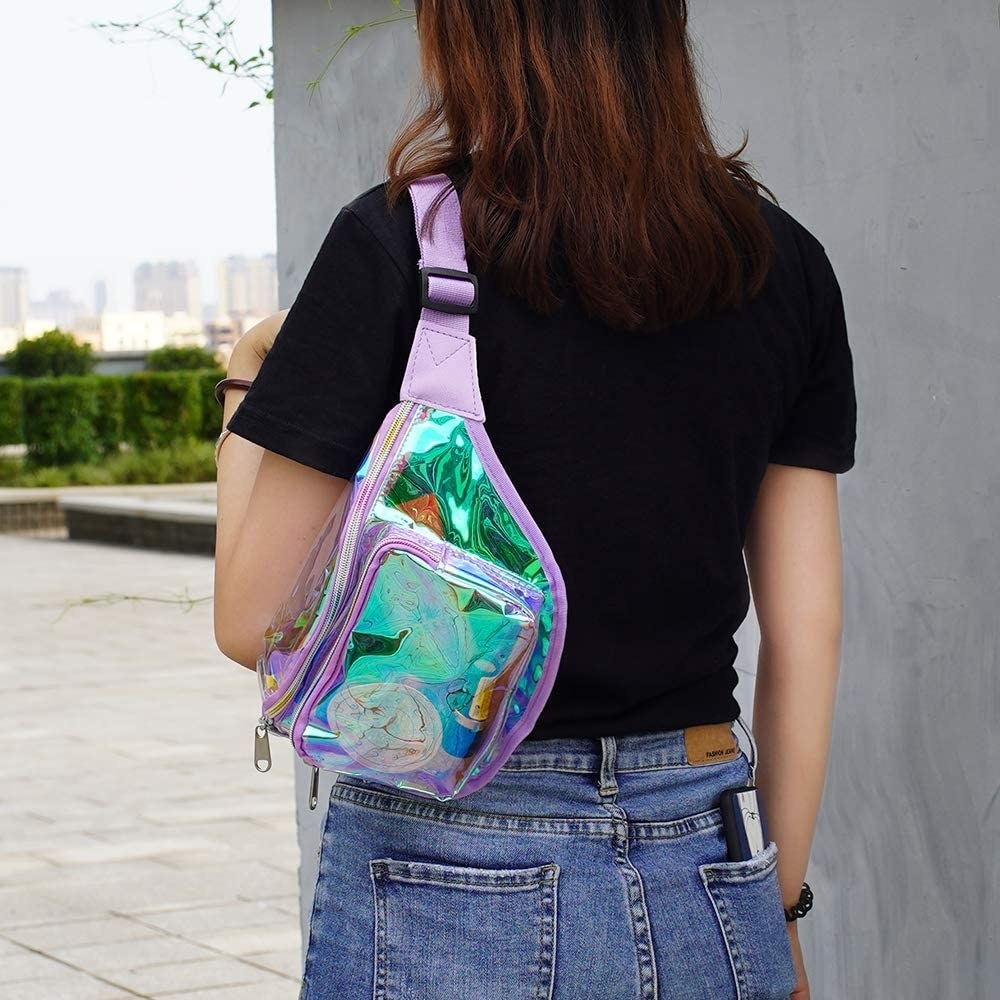 a model wearing the shiny purple bag over their shoulder