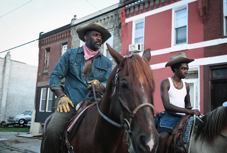 Idris Elba and Caleb McLaughlin on horseback