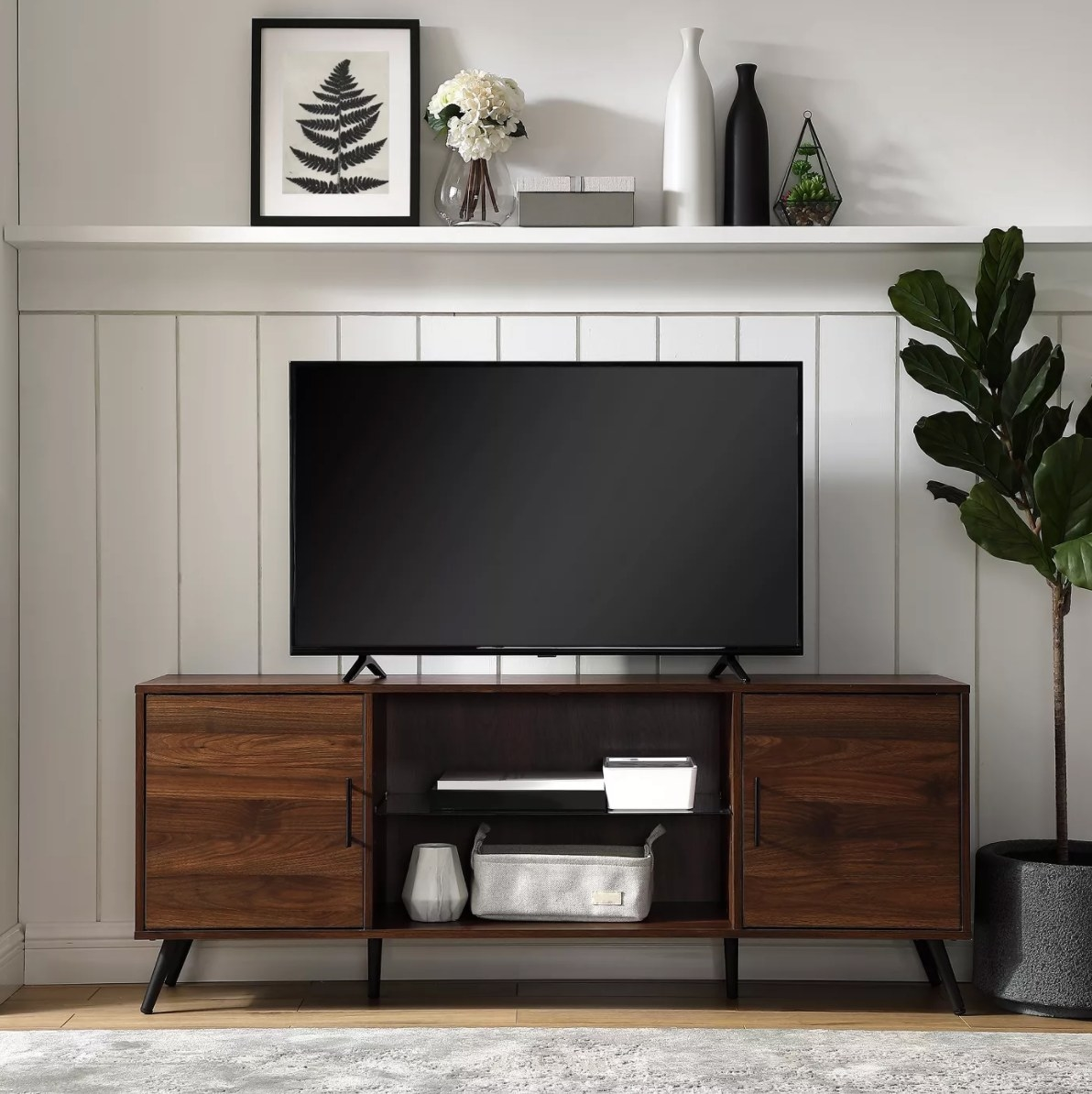 The midcentury wood console with a glass center