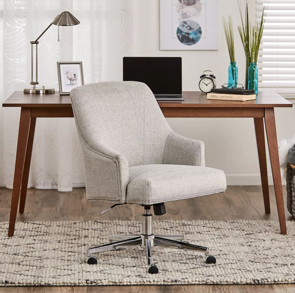 The home office chair in gray with metal legs and rolling wheels