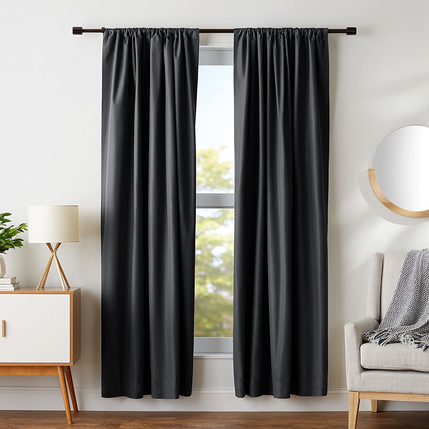 black blackout curtains hanging up on a window