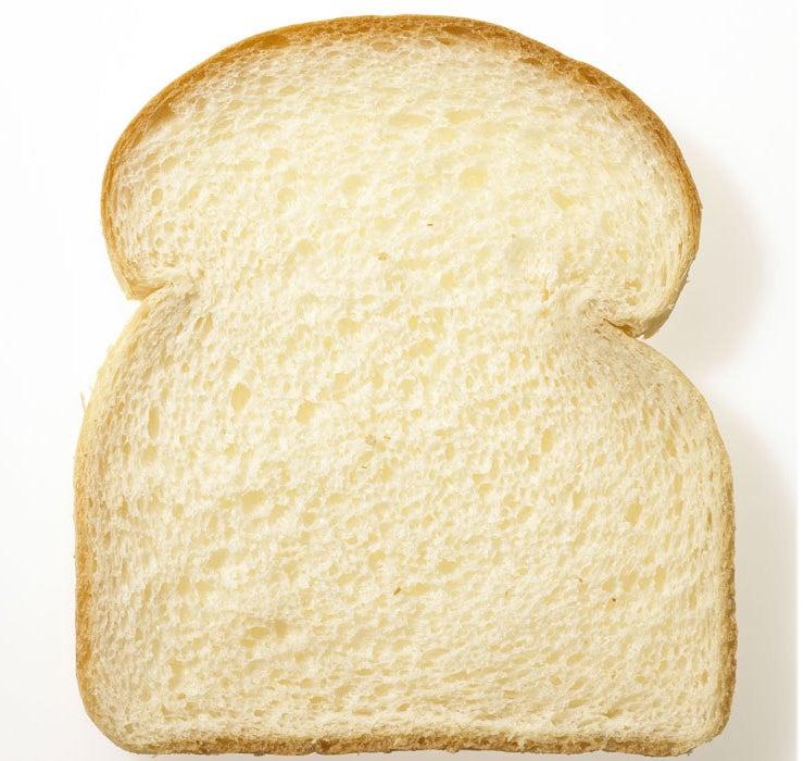 A slice of fluffy white bread.