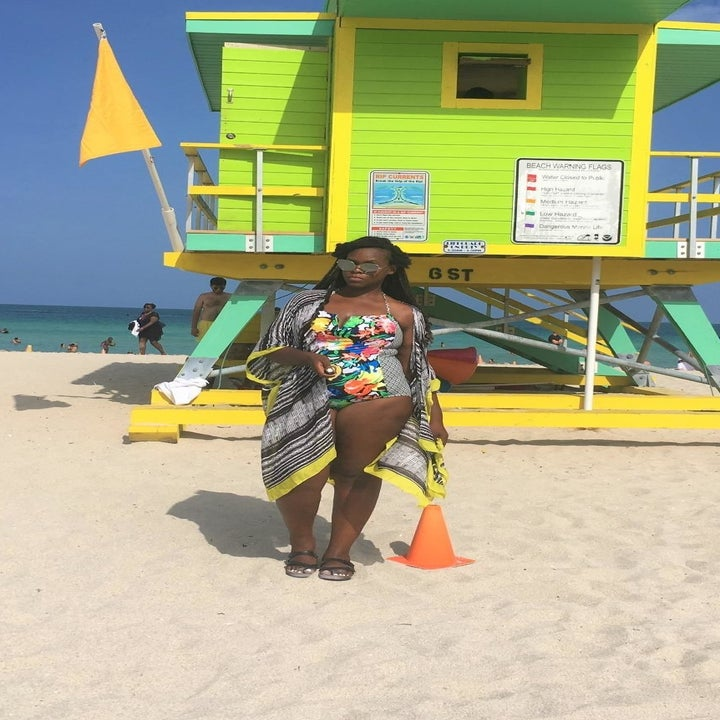 a different reviewer wearing the coverup in black and white pattern with yellow hem over a swimsuit