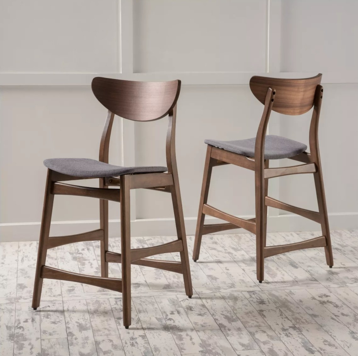 The set of two counter height barstool chairs with dark gray seats
