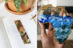 mirror bookmark on an open book page, hand holding up a gold and blue resin coaster in the shape of Africa