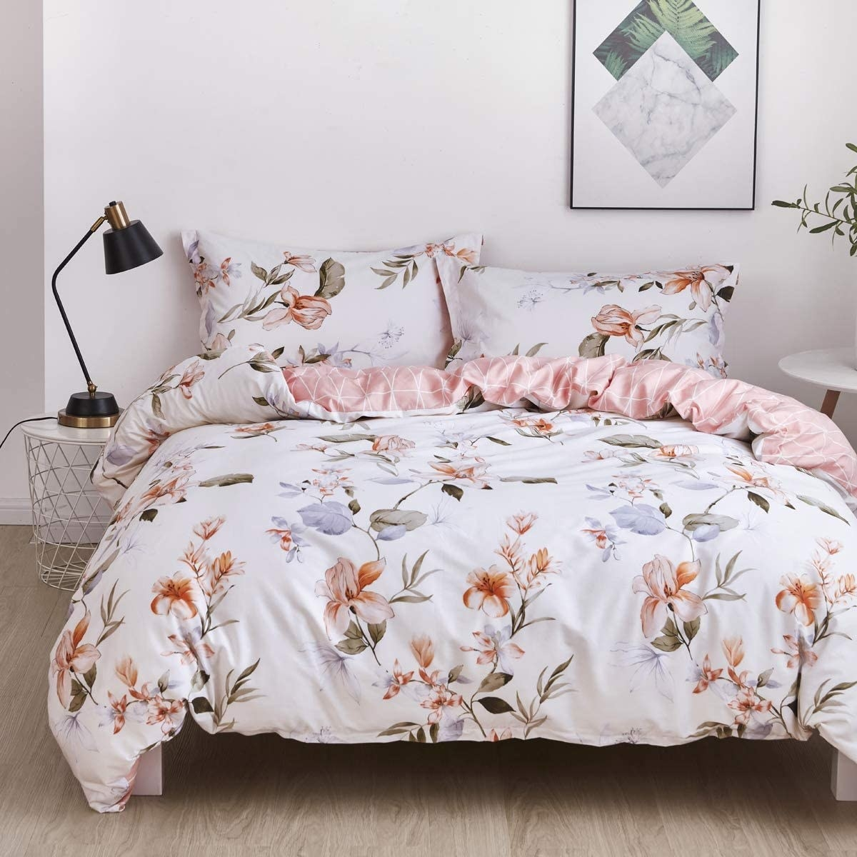 white floral duvet cover and pillow shams on a bed