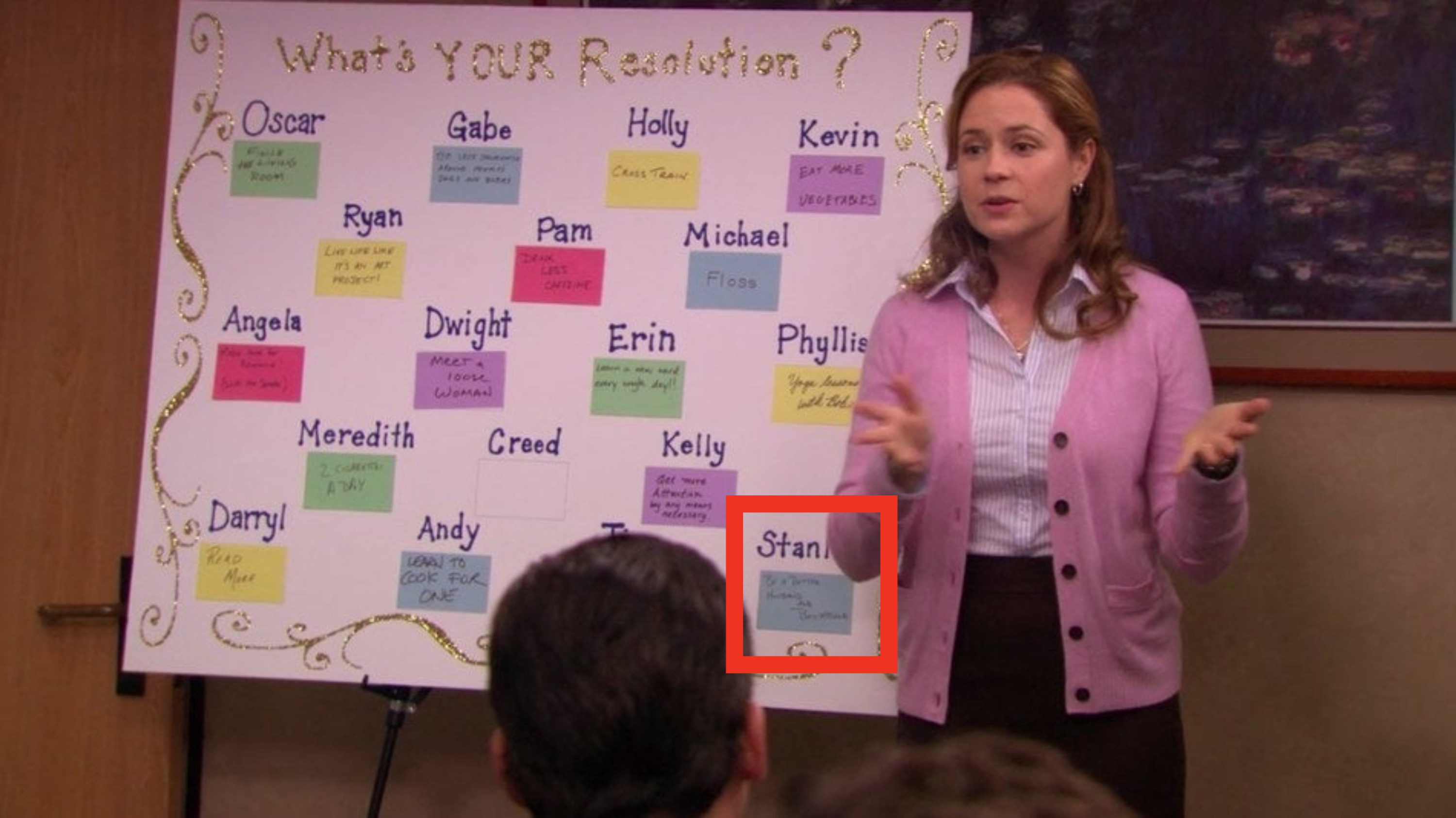 Pam leading a meeting about new years resolutions