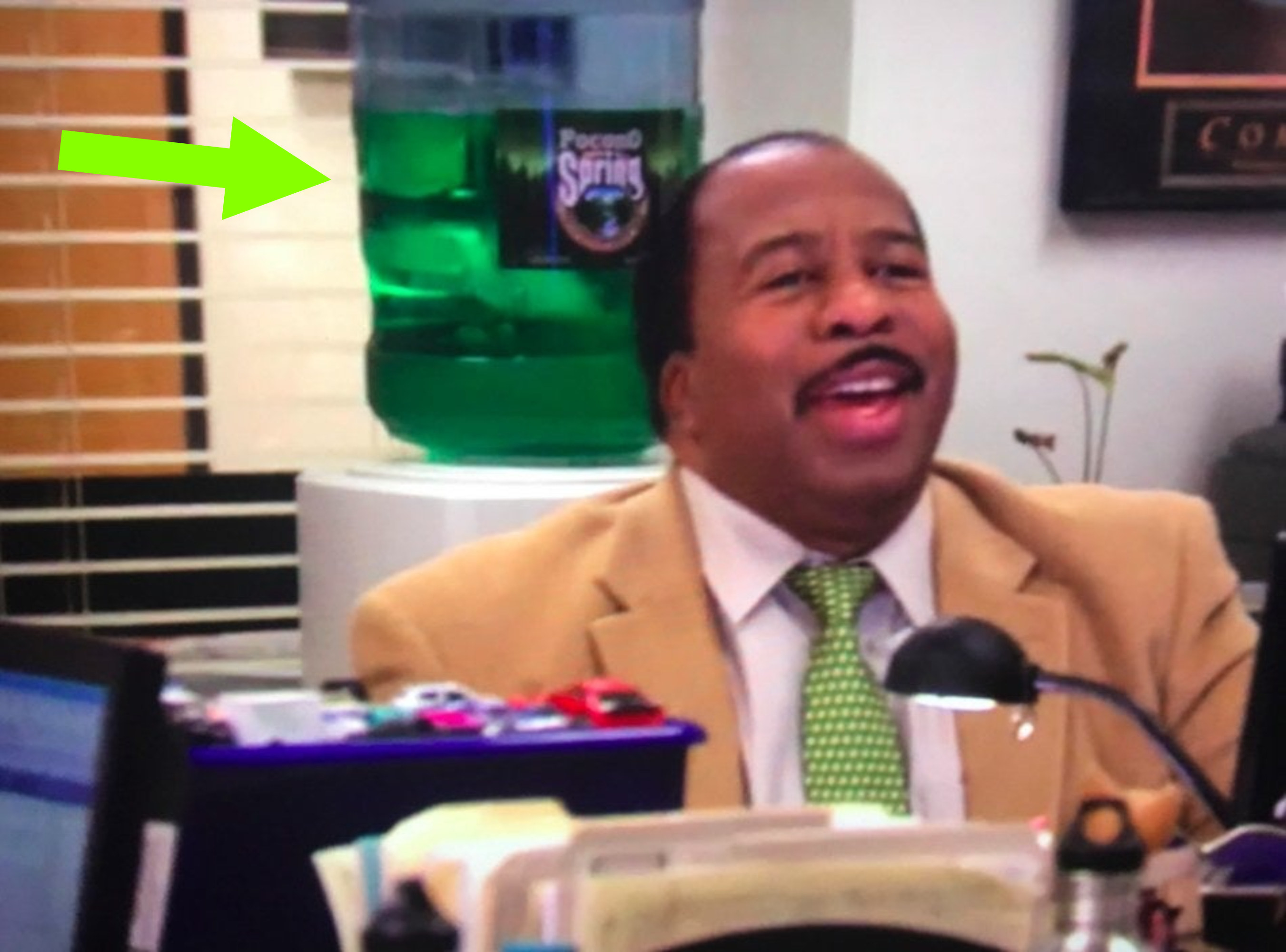 Stanley sitting at his desk and, in a rare occurrence, smiling