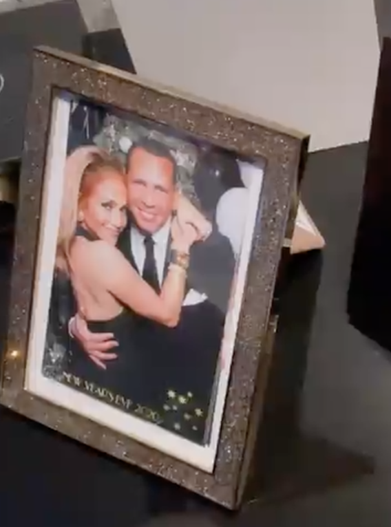 Framed photo of Arod and J.Lo with her arms around him as they smile
