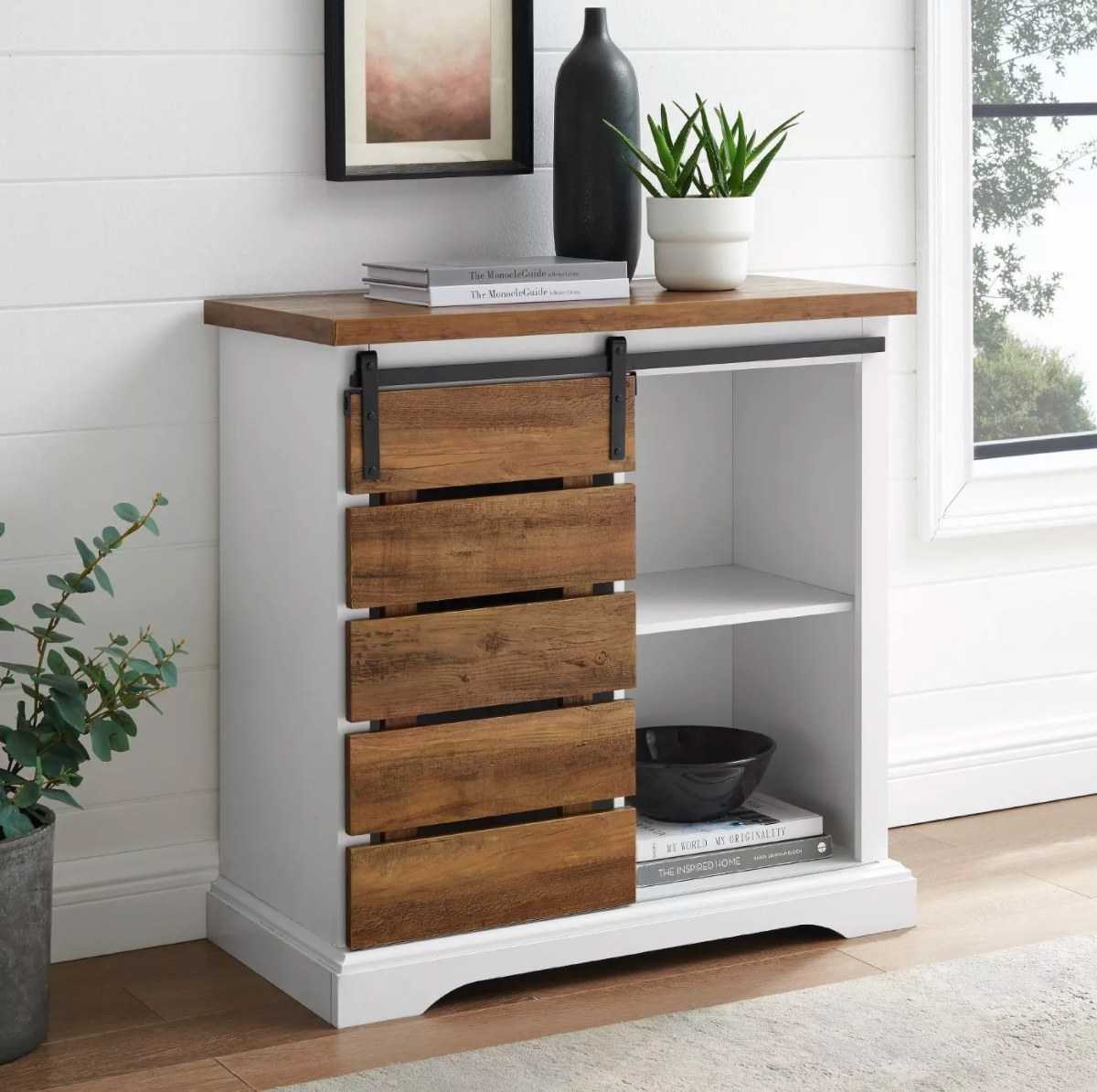 The rustic farmhouse buffet in white with wood doors and top