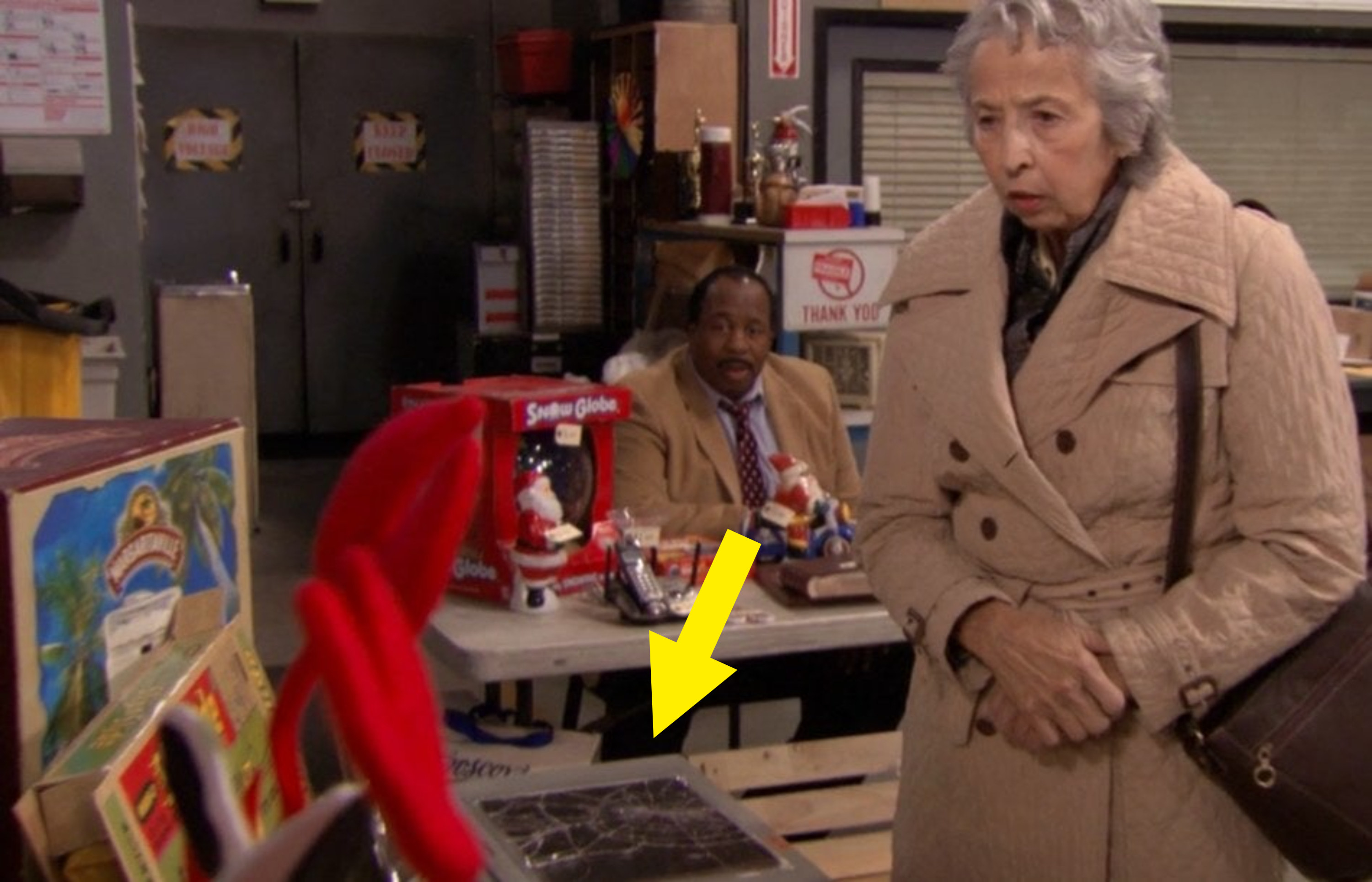 a random woman looking at Michael's garage sale objects