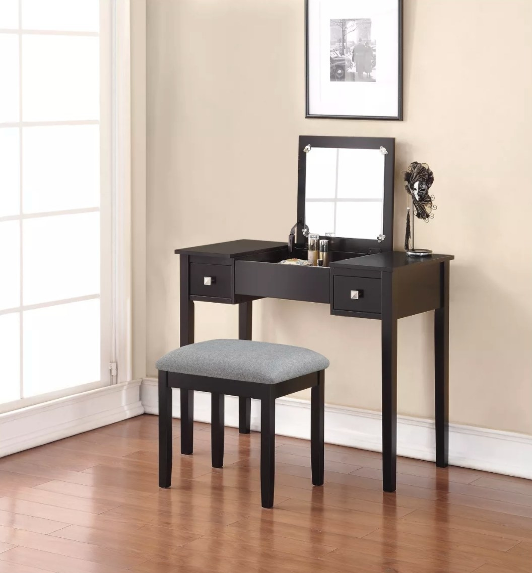 The vanity and stool set in black with a gray seat