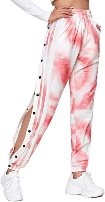 model in white and pink tie-dye snap pants