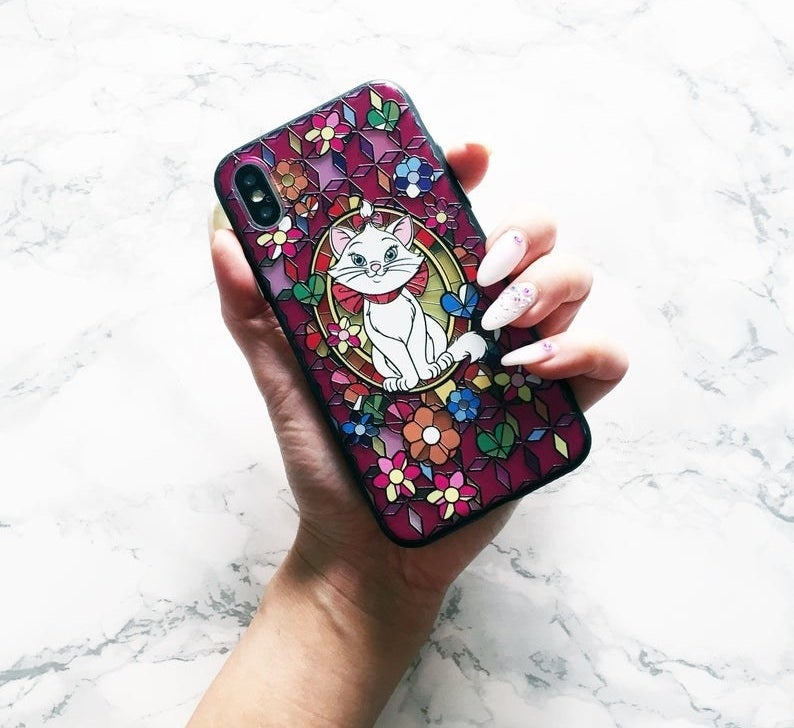 A vibrant phone case displaying Marie from Aristocats