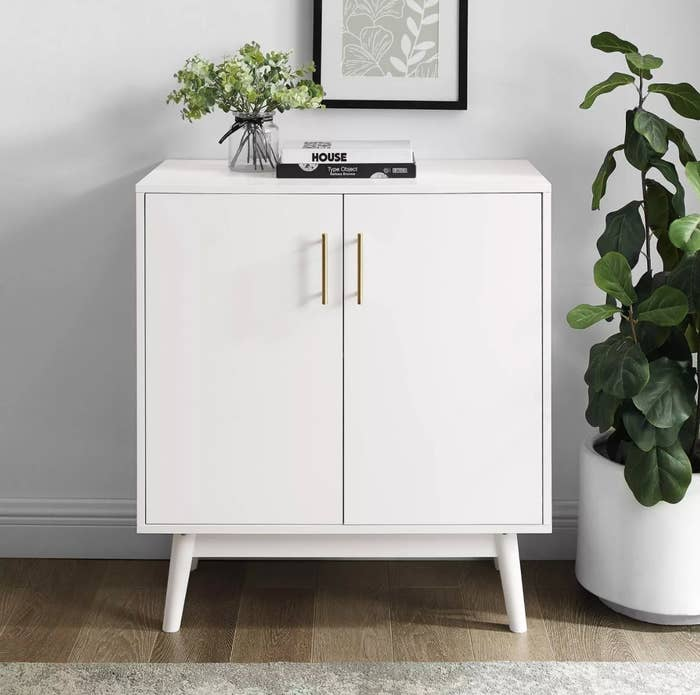 The midcentury modern accent cabinet in white