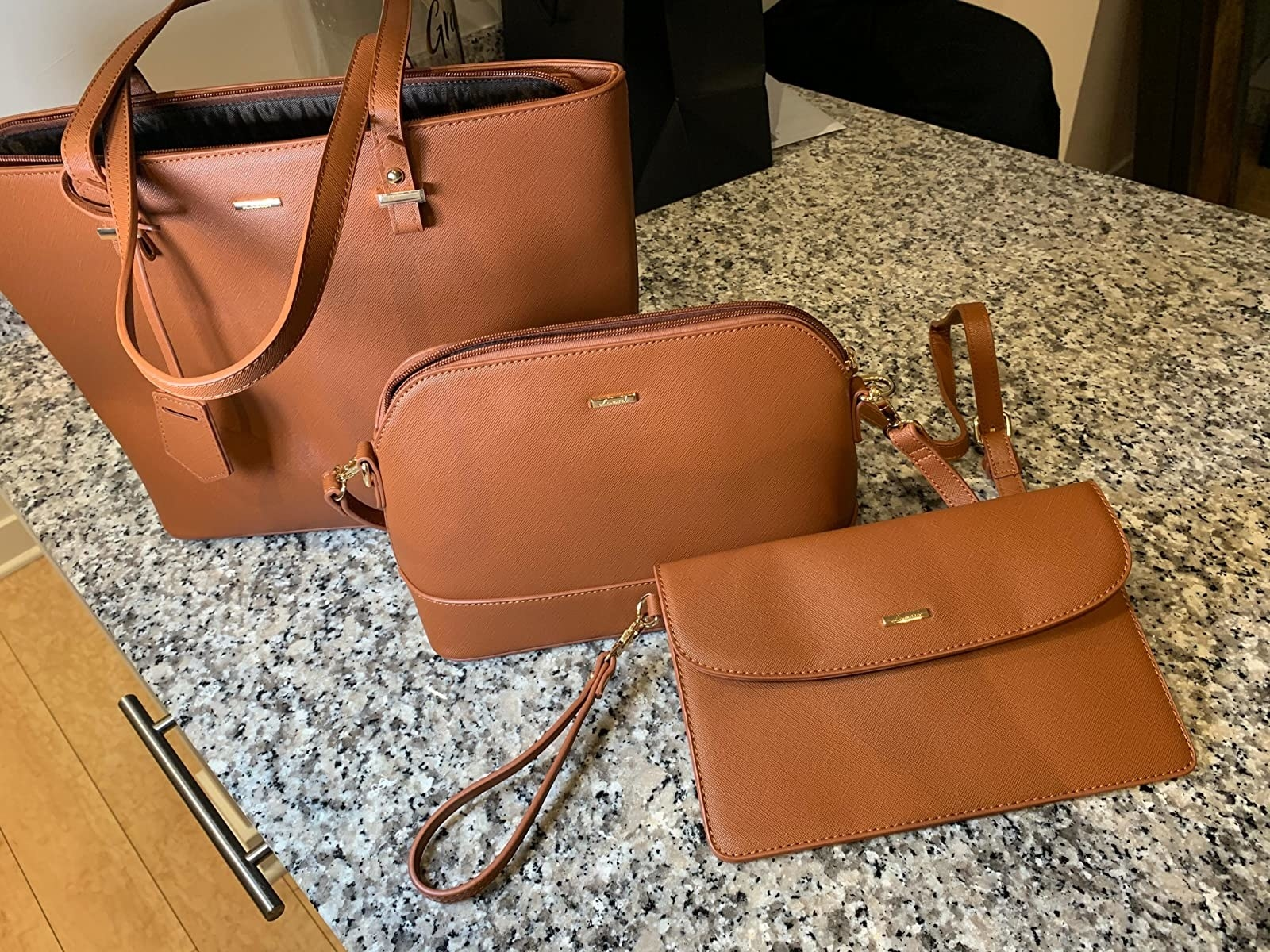 Three piece purse set on table