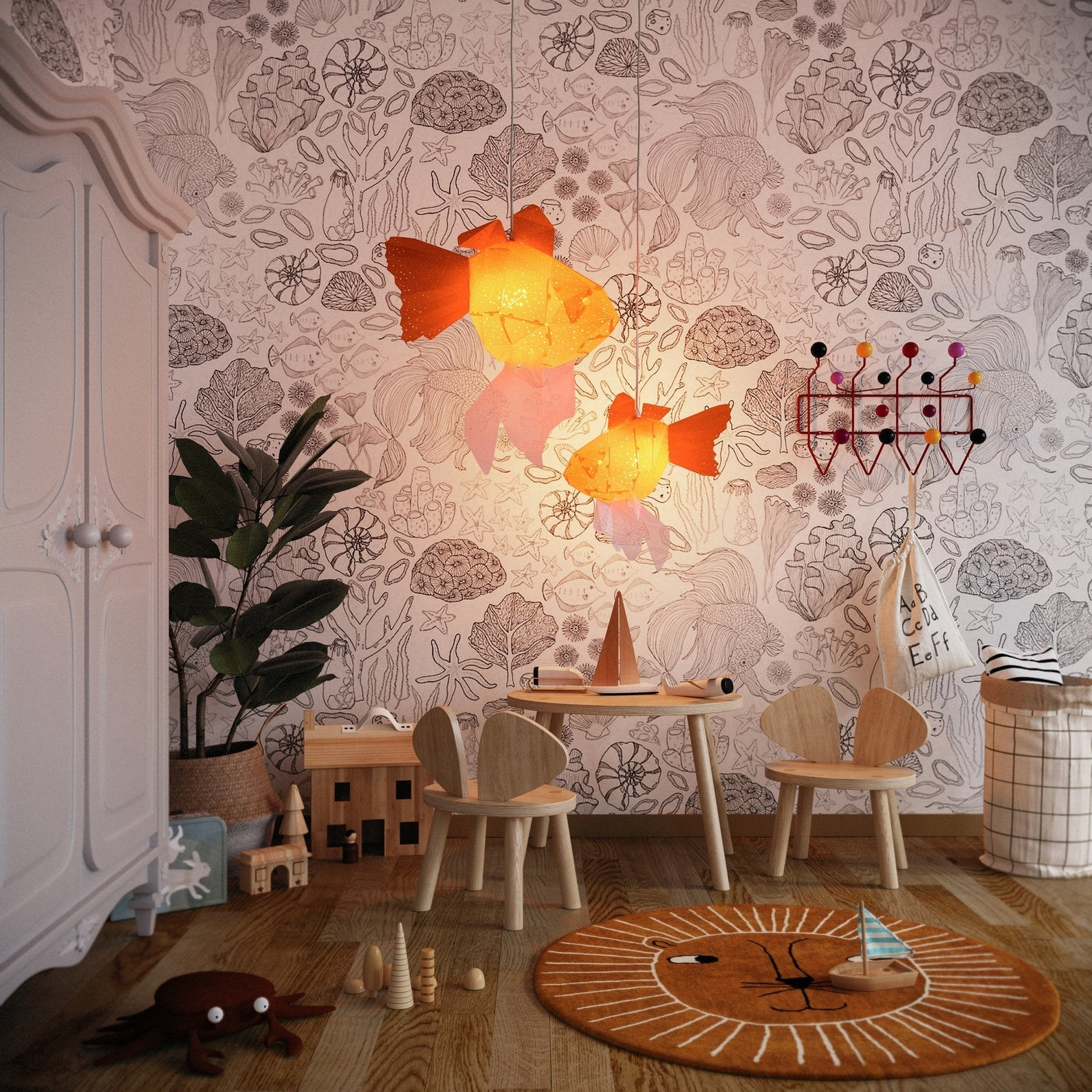 two orange goldfish chandeliers hanging in a kids room